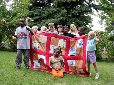 Children with quilt, historic image