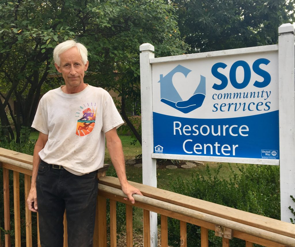Mike standing next to Resource Center sign