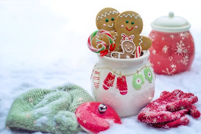 Winter scene of gingerbread in a mug with candy canes and mittens